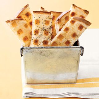 Create toast points with a chic and crunchy grid. Spread butter on sliced bread and then sprinkle it with an aromatic spice, such as fennel seed, cumin, paprika, or even just salt and pepper. Toast in a heated waffle iron.