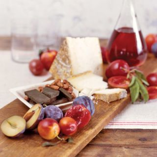<p>In the company of plums:</p><br><p><b>Spirited</b></p><p>The right wine paired with a ripe plum flatters both. Soft reds, such as zinfandels and Shiraz, balance plums that are sweeter, such as Yellow Egg and purple Friar. For tart plums, try gently perfumed dessert wines, such as a light, slightly sparkling Moscato d'Asti or an orange-scented Muscat de Baume-de-Venise.</p><p><b>Savory</b></p><p>Cheeses, particularly those with buttery, rich flavor, complement plums in much the same way as cream is lovely with berries. Here, Castelrosso, a cow's milk cheese from Italy's Piemonte region, is served, but silky Camembert and triple-cream, mousselike Saint Andre make equally good partners. </p><p><b>Sweet</b></p><p>Dark chocolate's deep flavors play well with a plum's honey notes. Lavender-infused Dragoba chocolate, shown here with hazelnuts, is a lovely companion. Something extra special? Serve truffles infused with ginger or brandy. </p>