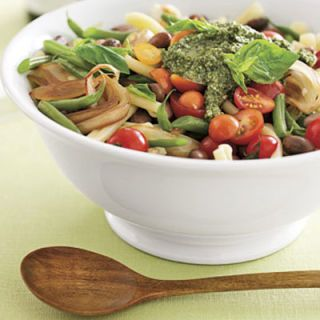 "This take on the traditional Italian bean and pasta dish features garden-fresh borlotti and green beans, topped with a generous amount of homemade pesto. Hearty enough for a main meal, this dish is also meatless. Going vegetarian once or twice a week is a great way to ""green"" your diet, and will most likely save you some money in the long run.