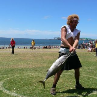 "Going on its 50th year, the main attraction at the Tunarama, held the weekend nearest to Australia Day (January 26) in Port Lincoln, Australia, is the World Champion Tuna Toss Competition, where participants hurl a roughly 20-pound tuna. The record — approximately 40 yards — was set in 1998 by a pro: former Olympic hammer thrower Sean Carlin.<br /><br />If eating tuna is more your thing, try one of these <a href=""/recipes/cooking-recipes/ideas-canned-tuna-recipes-video-122908"" target=""_blank"">canned tuna recipes</a>."