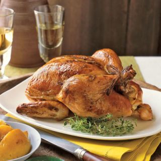 "A simple list of ingredients makes this impressive-looking main dish easy. A lemon inserted into the chicken's cavity during roasting keeps the meat moist and juicy; seasoning the skin with zest imparts great flavor <br /><br /> <b>Recipe:</b> <a href=""/recipefinder/roast-lemon-chicken-3677"" target=""_blank"">Roast Lemon Chicken</a>"