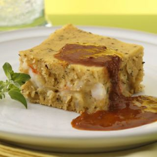 """<p>This version of tamales, made into a casserole rather than little cornhusk-wrapped bundles, can be whipped up in minutes. It's filled with shrimp, but this recipe works well stuffed with whatever you like. Quick-cooking seafood, such as scallops, cheese, or even some of the mole also make great fillings.</p><br /><br /><p><a href=""""/recipefinder/shrimp-tamale-casserole-three-sisters-black-mole-recipe-6764"""" target=""""_blank""""><b>Get this recipe!</b></a></p>"""