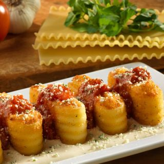 """<p>New-Twist Menu Item: <a href=""""http://www.olivegarden.com/default_f.asp"""" target=""""_blank""""><b>Lasagna Fritta</b></a></p><br /><p>What's better than cheesy, Parmesan-dusted lasagna? <i>Fried</i> bite-size portions of cheesy Parmesan-dusted lasagna, according to the folks at the Olive Garden. On a recent idea-generating trip to northern and central Italy, the menu-development team came across a street-food version of the oven-baked Italian favorite. The bite-size Parmesan-crusted fried lasagna pieces are arranged atop a pool of alfredo sauce, topped with marinara sauce and still more Parmesan.</p>"""