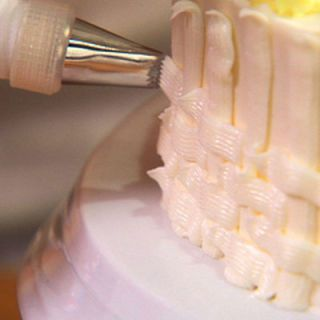 "Classic frosting rosettes and basket weaving may look like advanced techniques, but they're actually easy to do!<br /><br /><b>Video: <a href=""/recipes/cooking-videos/how-to-pipe-cake-frosting"" target=""_blank"">Get step-by-step frosting-piping instructions.</a></b>"