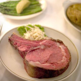 "<p>At the Prime Rib, it's always 1965 — the year it opened. The leopard-print dining room looks like George Steinbrenner's private club. The waiters wear tuxes. You wear a jacket. And the kitchen roasts the majestic prime rib, on the bone, its collar of fat suffused into the inner layer, the core a rose red, all of it giving off the intoxicating aroma of old money. <i>(<a href=""http://www.theprimerib.com/"" target=""_blank"">The Prime Rib</a>; 1101 North Calvert Street, Baltimore, MD; 410-539-1804)</i></p><br /> <b>Try This At-Home Recipe:</b> <a href=""/recipefinder/three-ingredient-prime-rib-roast-recipe"" target=""_blank""><b>Three-Ingredient Prime Rib Roast</b></a></p>"