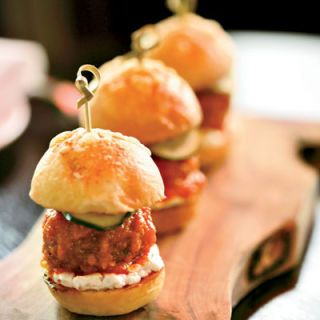 "Except for the Italian goat cheese, every part of <a href=""http://locandaverdenyc.com/"" target=""_blank"">Locanda Verde</a>'s lamb-meatball sliders is made in-house: Andrew Carmellini grinds the lamb with onion, simmers the <a href=""/recipes/cooking-recipes/meatballs"" target=""_blank"">meatballs</a> in tomato sauce, then serves them on Parmesan-onion buns with cucumber pickles ($12 per order). They're fantastic and reminiscent of the old-school type — the kind one might think Carmellini grew up with.<br /> —<i>Kate Krader</i>"
