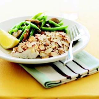 "<p>Appealingly mild and lean, tilapia still has plenty of heart-healthy omega-3 fats. (Bonus: It is one of the least mercury-laden fish, and is also low in sodium.) Green beans and mushrooms deliver fiber and potassium, while crunchy almonds boast antioxidants.</p><br /> <p><b>Recipe: </b><a href=""/recipefinder/almond-crusted-tilapia-recipe"" target=""_blank""><b>Almond-Crusted Tilapia</b></a></p>"
