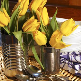 For a bit of country flair, found household objects work wonderfully as vases; they only have to hold water! We used old soup cans with these tulips, but mason jars, watering cans, and wine bottles can be great picks too. When using unusual containers, floral foam can keep blooms in place. Cut it to the needed shape and insert it in your container; this will make arranging much easier. After watering the foam, wrapping it in foil can make any container waterproof, including wicker baskets.