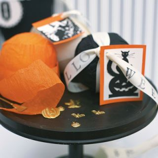 <p>PARTY FAVOR CRAFTS<br /> <p>Clear a space on your table, gather your supplies (listed below), and get ready for an afternoon spent making an assortment of holiday crafts: stamped ribbons and streamers, trinket-filled crepe-paper Halloween balls, and fanciful silhouette cards.</p> <p>SUPPLIES:<br /> -ribbon -alphabet stamps and stamp pad -Styrofoam balls -crepe paper -trinkets -straight pins -orange card stock
