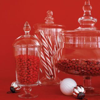 "<b>...aren't the only visions dancing in their heads.</b><br /> A sweet idea: Decorate a sideboard with apothecary jars filled with red and white candies.<br /> (Find similar jars at <a href=""http://www.zgallerie.com""target=""_blank"">zgallerie.com</a> and <a href=""http://www.potterybarn.com""target=""_blank"">potterybarn.com</a>.)"
