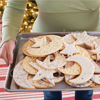 Transport cookies on a sheet pan or board before adorning your tree with them.
