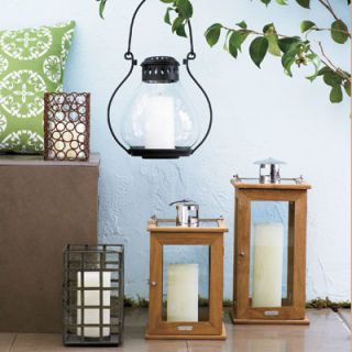 """<b>Tip:</b> Mix mismatched lanterns to create a magical evening glow. <br /><br /><b>Martha Stewart Everyday square lantern</b>, $15, Kmart, <a href=""""http://www.kmart.com/"""" target=""""_blank"""">kmart.com</a> for stores. <br /><b>Napa lantern in medium</b>, $39, <a href=""""http://www.potterybarn.com/"""" target=""""_blank"""">potterybarn.com</a>. <br /><b>Teak lanterns</b>, $39 (small) and $59 (large), Smith & Hawken, <a href=""""http://www.smithandhawken.com/"""" target=""""_blank"""">smithandhawken.com</a>. <br /> <b>Plantation Patterns indoor/outdoor pillow</b>, $13, <a href=""""http://www.homedepot.com/"""" target=""""_blank"""">homedepot.com</a> for stores."""