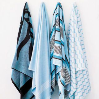 """Set out coordinating towels for every person at your pool party — all guests have to bring is their bathing suits! <br /><br /><b>Palm leaf towel</b>, $28, Studio by JCPenney Home Collection, 877-FIND-JCP. <br /><b>ABH Designs beach towel</b>, $55, 212-249-2276. <br /><b>Santa Barbara striped towel in aqua</b>, $39, <a href=""""http://www.restorationhardware.com"""" target=""""_blank"""">restorationhardware.com</a>.<br /><b>Wave beach towel in vista blue</b>, $18, Lands' End, <a href=""""http://www.landsend.com/"""" target=""""_blank"""">landsend.com</a>."""