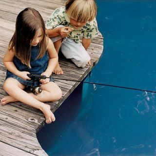 Ruby McClinton, age 4, and Meade Olson, age 5, wait for fish to bite.