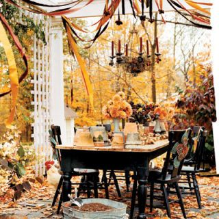 A sunny fall weekend afternoon is the perfect time to gather with friends to do a little digging. Position a table outdoors under a pergola or grand old tree. Set out terra-cotta pots, trowels, and spring-blooming bulbs. Use galvanized washtubs or sap buckets to hold soil. To add seasonal drama, hang a wire chandelier adorned with seeded eucalyptus, papery daffodil bulbs, and tapers in autumnal oranges and reds. Glorious bouquets of bright dahlias and plump pumpkins placed on the ground complement the turning leaves.