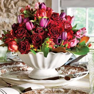 <p>Allow time-honored family heirlooms to mingle with new treasures. In lieu of typical autumn blooms,   display roses and tulips — but arrange them in a classic ironstone compote. Abundance, the season's   theme, calls for a table brimming with beautiful color. In short: Relax, be yourself — and enjoy.</p>