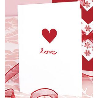 The front of this card is as simple as can be — a single red paper heart glued to a white card, with the word <em>love</em> written in a crimson script below. Because, really, what more do you need to say?