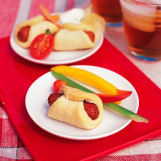 "It was 60 years ago at the Texas State Fair that Neil Fletcher invented the ""corny dog,"" a sausage on a stick, dipped in corn-bread batter and fried. This oven-baked version is a treat for kids of all ages.<br /><br /> <b>Recipe: <a href=""/recipefinder/mini-corn-dogs-1953""target=""_new"">Mini Corn Dogs</a></b>"