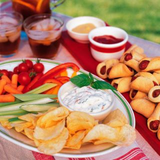 "All the ingredients for this easy dip get pulsed in the food processor. Serve with cut-up veggies and/or sturdy potato chips.<br /><br /> <b>Recipe: <a href=""/recipefinder/sun-dried-tomato-dip-1117""target=""_new"">Sun-Dried Tomato Dip</a></b>"
