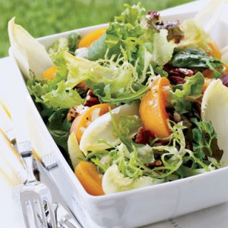 """<p>This picnic-perfect salad features jewel-toned apricots, toasted pecans, and Belgian endive, all dressed in a light Champagne vinaigrette. Transport salad components in separate plastic bags and combine just before eating.</p><br /><p><b>Recipe: <a href=""""/recipefinder/greens-apricots-champagne-vinaigrette"""" target=""""_blank"""">Mixed Greens with Apricots and Champagne Vinaigrette</a></b></p>"""