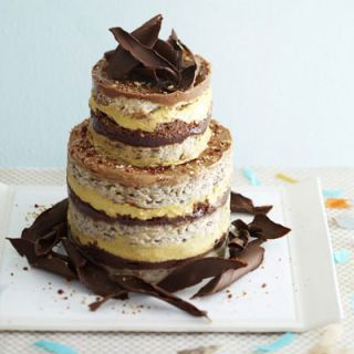 "<p>Pastry chef Christina Tosi oversees the desserts at David Chang's four Momofuku restaurants in New York City. She also has her own bake shop, Momofuku Milk Bar. Tosi likes to combine intense, well-balanced flavors and textures in her desserts. She baked up this supermoist banana cake, then added four distinctive fillings and toppings — banana cream, hazelnut crunch, chocolate hazelnut ganache, and hazelnut frosting. The effect is ""creamy, crunchy, fudgy,"" says Tosi.