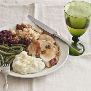"<p>""Salt-pork fatback's the secret to the wonderful flavor of Southern-style green beans,"" says Randall.</p><br /> <h2>Recipes</h2> <p><b>Turkey:</b> <a href=""/recipefinder/butter-roasted-turkey-giblet-pan-gravy-recipe-clv1110""target=""_blank""><b>Butter-Roasted Turkey with Giblet Pan Gravy</b></a></p> <p><b>Stuffing:</b> <a href=""/recipefinder/cornbread-dressing-sage-pork-sausage-recipe-clv1110""target=""_blank""><b>Cornbread Dressing with Sage and Pork Sausage</b></a></p> <p><b>Potato:</b> <a href=""/recipefinder/mom-pans-creamy-mashed-potatoes-recipe-clv1110""target=""_blank""><b>Mom Pan's Creamy Mashed Potatoes</b></a></p> <p><b>Cranberry:</b> <a href=""/recipefinder/sun-dried-cherry-cranberry-salsa-recipe-clv1110""target=""_blank""><b>Sun-Dried Cherry and Cranberry Salsa</b></a></p> <p><b>Wild Card:</b> <a href=""/recipefinder/southern-style-green-beans-recipe-clv1110""target=""_blank""><b>Southern-Style Green Beans</b></a></p><br /> <p><b>Wine Pairing:</b> Valley of the Moon Pinot Blanc 2008 <i>($13.49; <a href="" http://www.wine.com/V6/Valley-of-the-Moon-Pinot-Blanc-2008/wine/104795/detail.aspx""target=""_blank"">wine.com</a>)</i></p>"