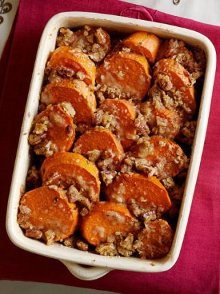 "<p>These traditional candied yams, which waft scents of butter, brown sugar, and cinnamon while baking, complete any dinner menu.</p> <p><strong>Recipe:</strong> <a href=""../../../recipefinder/praline-candied-garnet-yams-recipe"" target=""_blank""><strong>Praline Candied Garnet Yams</strong></a></p>"