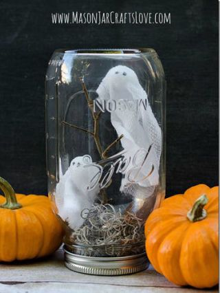 """<div class=""""imageContent""""> <p>Pick up some Styrofoam, twigs, moss, and gauze, and turn an old Mason jar into a ghostly scene.</p> <p><strong>Get the tutorial at <a href=""""http://masonjarcraftslove.com/ghosts-in-mason-jars/"""" target=""""_blank"""">Mason Jars Craft Love</a>.</strong></p> </div>"""