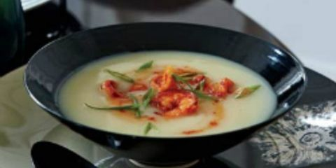 """<p>This silky potato soup is perked up with Turkish red-pepper paste (biber salcasi), made from sweet and hot peppers. Look for the paste at Middle Eastern groceries, or use harissa instead.</p> <p><b>Recipe: <a href=""""http://www.delish.com/recipefinder/potato-soup-spicy-shrimp-recipe-fw1210?click=recipe_sr""""> Potato Soup with Spicy Shrimp</a></b></p>"""