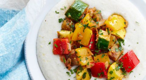 """<p>Coconut milk turns plain grits into a creamy, slightly sweet base — the perfect balance for this medley of late-summer veggies.</p><p><strong>Recipe: <a href=""""http://www.delish.com/recipefinder/spiced-ratatouille-coconut-grits-recipe-ghk0914"""" target=""""_blank"""">Spiced Ratatouille With Coconut Grits</a></strong></p>"""