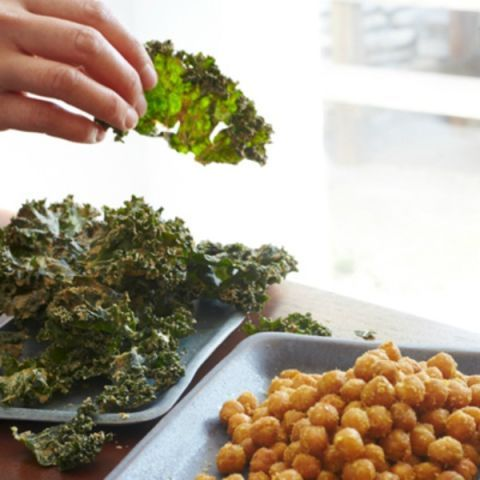 "<p>""We have an entire garden bed dedicated to kale that we use for these chips,"" says Sera Pelle. She usually makes them in a dehydrator, but the oven method here works perfectly, too.</p> <p><b>Recipe: <a href=""http://www.delish.com/recipefinder/kale-chips-almond-butter-miso-recipe-fw0312?click=recipe_sr""> Kale Chips with Almond Butter and Miso</a></b></p>"
