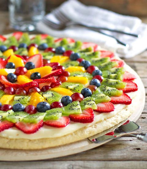 """<p>Decorate your slices with bright mango, kiwi, grapes and berries for a treat that thrills eyes and taste buds alike.</p> <p>Get the recipe at <a href=""""http://pinchofyum.com/fruit-pizza"""" target=""""_blank"""">Pinch of Yum</a>.</p> <div> </div>"""