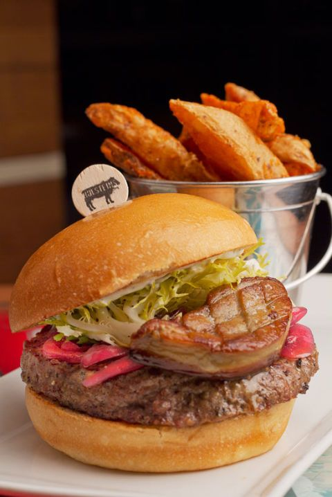 "<p>In the quest for the most decadent burger, there's some tough competition. Vying for the top stop is <a href=""http://www.holsteinslv.com/"" target=""_blank"">Holsteins'</a> Billionaire Burger. Luckily for you, the name refers to how rich you'll <em>feel</em>, not how rich you have to be to buy the two-handed towering meal. This burger starts with a Kobe beef patty and just gets increasingly rich. Perched on the Kobe patty is port-onion marmalade, truffle mayo, and a generous helping of foie gras — yes, foie gras!</p> <p><em><strong>Holsteins Shakes and Buns:</strong> 3708 S Las Vegas Blvd, Las Vegas, NV 89109; (702) 698-7940; <a href=""http://www.holsteinslv.com/"" target=""_blank"">holsteinslv.com</a></em></p>"