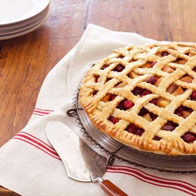 "Add a few drops of lemon juice to brighten and balance the fruits <a href=""http://www.delish.com/recipefinder/pear-cranberry-lattice-pie-recipes"" TARGET=""_blank"">in this pie</a>. Then brush the crust with a beaten-egg glaze to create a bakery-worthy golden sheen."