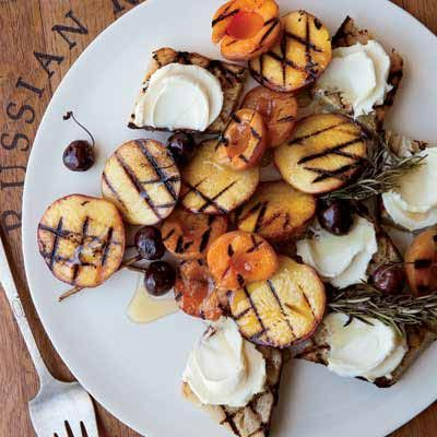 This knife-and-fork dessert is a fantastic showcase for seasonal fruit at its peak; caramelizing the fruit on the grill intensifies its flavor. The grilled bread served alongside soaks up the sweet juices.