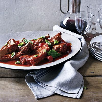 "<p>Spiced up with pickled chilies, this dish gets a kick from tangy Italian tomato puree. These ribs are a delicious departure from standard barbecue.</p><br /><p><b>Recipe: <a href=""/recipefinder/pork-ribs-garlic-chilies-tomato"" target=""_blank"">Pork Ribs with Garlic, Chilies, and Tomato</a></b></p>"