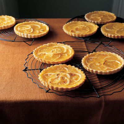 "<p>The perfume of individual lemon tarts fills the room as they bake. The Shakers get credit for this dessert with a lemony pucker-worthy filling that's baked in piecrust shells.</p> <p><strong>Recipe:</strong> <a href=""http://www.delish.com/recipefinder/classic-shaker-lemon-tarts-recipe-mslo0513"" target=""_blank""><strong>Classic Shaker Lemon Tarts</strong></a></p>"