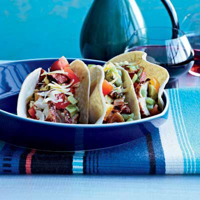 "<p>At New York City's <a href=""http://dostorosnyc.com/"" target=""_blank"">Dos Toros</a>, brothers Leo and Oliver Kremer offer amazing San Francisco-style tacos, like these zesty, grilled-chicken tacos, as well as burritos, and quesadillas — all simple, fresh, and sustainable.</p><p><b>Recipe: <a href=""/recipefinder/grilled-chicken-tacos-recipe-fw0510"" target=""_blank"">Grilled-Chicken Tacos</a></b></p>"