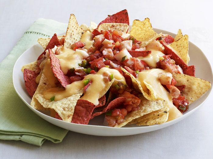 "<p>Pre-cooked lobster meat dresses up the standard plate of nachos, but doesn't add any extra cooking time to this recipe.</p><p><strong>Recipe:</strong> <a href=""/recipefinder/lobster-nachos-recipe-rbk0511""><strong>Lobster Nachos</strong></a></p>"