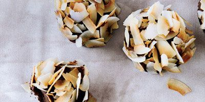 """<p>It's hard to eat just one of these cupcakes, which combine moist, light chocolate cake with rich, chocolate-caramel frosting and flaky coconut.</p><p><b>Recipe: </b><a href=""""http://www.delish.com/recipefinder/chocolate-cupcakes-caramel-ganache-coconut-recipe-fw0213"""" target=""""_blank""""><b>Chocolate Cupcakes with Caramel Ganache and Coconut</b></a></p>"""