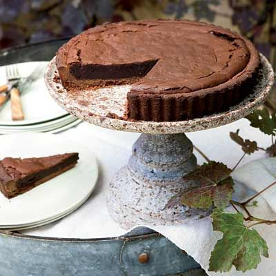 """<p>This rich tart is like a dark-chocolate truffle in a crisp, flaky cocoa crust. Bourbon adds a wonderful smokiness&#x3B; be sure to heat it carefully with the sugar so it doesn't ignite.</p><p><b>Recipe: </b><a href=""""http://www.delish.com/recipefinder/chocolate-bourbon-tart-recipe-fw1010"""" target=""""_blank""""><b>Chocolate-Bourbon Tart</b></a></p>"""