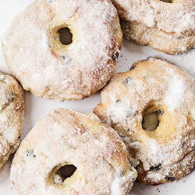 "<p>Christy Timon opened her bakery <a href=""http://www.clearflourbread.com/"" target=""_blank"">Clear Flour Bread</a> in 1982, hiring Abram Faber to help with deliveries. The now-married couple are revered as early champions of classic European baking. They continue to hunt down rare recipes, like these light, baked doughnuts spiced with nutmeg and cinnamon and adapted from Robert Jörin, a third-generation Swiss baker at the Culinary Institute of America at Greystone.</p><p><b>Recipe:</b> <a href=""/recipefinder/baked-currant-doughnuts-recipe-fw0710"" target=""_blank""><b>Baked Currant Doughnuts</b></a>"