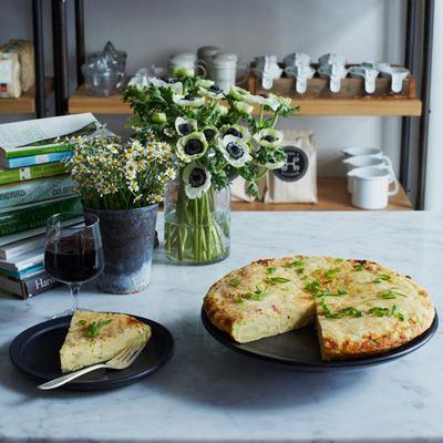 """<p>Made with 18 eggs, two cups of cheese, and one cup of cream, this frittata makes a decadent brunch dish for a crowd.</p><p><b>Recipe: </b><a href=""""http://www.delish.com/recipefinder/potato-scallion-frittata-manchego-cheese-recipe-recipe-fw0113""""><b>Potato-Scallion Frittata with Manchego Cheese</b></a></p>"""