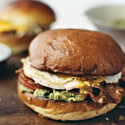 """<p>Breakfast and lunch on one bun, this indulgent take on Cobb salad stacks avocado, blue cheese, turkey, crisp bacon, and a gently cooked egg, which bathes the layers in rich golden goodness.</p> <p><strong>Recipe:</strong> <a href=""""http://www.delish.com/recipefinder/turkey-cobb-sandwich-recipe-mslo1112""""><strong>Turkey Cobb Sandwich</strong></a></p>"""