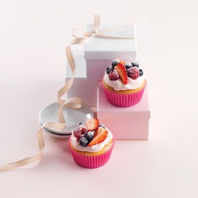 <p>Color unwhipped chilled heavy cream pale pink. Whip the cream until it barely holds its shape. Top each cake with cream and a mixture of your favorite berries — we used blueberries, raspberries, and strawberries. Dust the berries with a little sifted powdered sugar.</p>