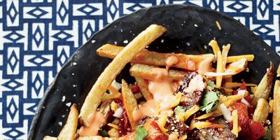 """<p>Austin is loaded with food trucks, and the Korean-Mexican-Texan mash-up that is Chi'Lantro is one of chef Aarón Sanchez's favorites.</p><p><b>Recipe: </b><a href=""""/recipefinder/french-fries-bulgogi-caramelized-kimchi-recipe-fw0512"""" target=""""_blank""""><b>French Fries with Bulgogi and Caramelized Kimchi</b></a></p>"""