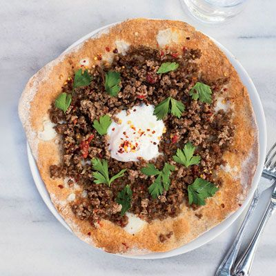 "<p>At her takeout shop in Istanbul, Kantin Dükkan, Semsa Denizsel tops her pizzas with ground lamb (flavored with sweet sun-dried tomatoes and a little spicy red pepper), but you can substitute ground beef instead.</p> <p><b>Recipe: </b><a href=""/recipefinder/turkish-ground-lamb-pizzas-recipe-fw0512"" target=""_blank""><b>Turkish Ground-Lamb Pizzas</b></a></p>"