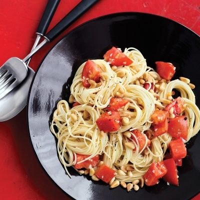 """<p>This simple pasta dish gets kicked up a notch with pine nuts and juicy tomatoes.</p><p><b>Recipe:</b> <a href=""""/recipefinder/pasta-fresh-tomatoes-pine-nuts-recipe-mslo0613"""" target=""""_blank""""><b>Pasta with Fresh Tomatoes and Pine Nuts</b></a></p>"""