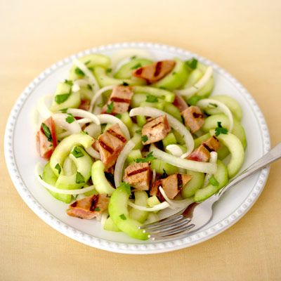 "<p>In this light dish, savory teriyaki-marinated tuna steak is grilled lightly and then paired with a refreshing cucumber salad.</p> <p><strong>Recipe:</strong> <a href=""../../../recipefinder/grilled-tuna-marinated-cucumber-salad-recipe"" target=""_blank""><strong>Grilled Tuna and Marinated Cucumber Salad</strong></a></p>"