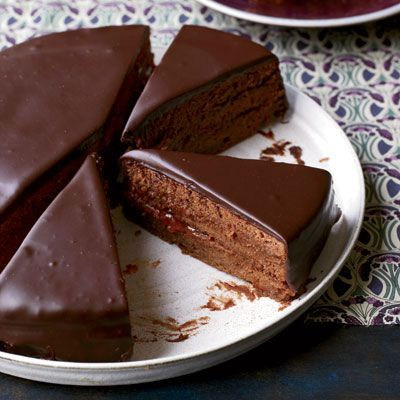 "<p>Sacher torte is a classic Austrian chocolate cake layered with apricot preserves. Lidia Bastianich's version uses the preserves three ways: for moistening the cake layers, as a thick filling between the layers, and as a glaze to seal the cake before covering it in chocolate. The cake is moist and luscious on its own, but it's also delicious served the traditional way, with unsweetened whipped cream. </p><p><b>Recipe:</b> <a href=""/recipefinder/sacher-torte-recipe-fw0512""><b>Sacher Torte</b></a></p>"